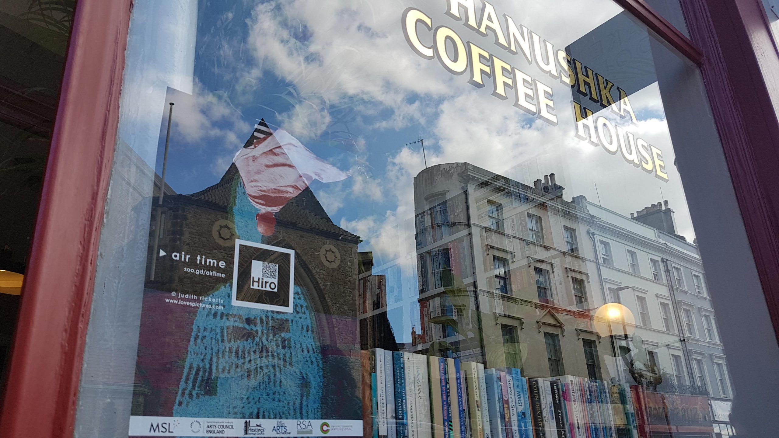 Air Time poster in Hanushka Coffe House window Hastings