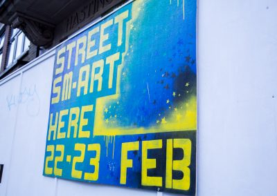 Photo of spray painted poster advertising Streetsmart on 22 and 23 Feb at the Observer Building