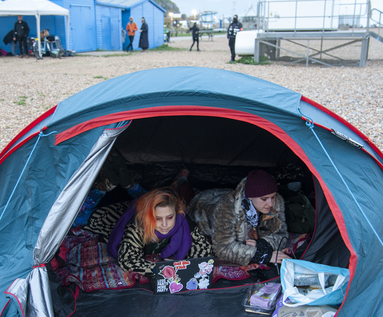 Women in tent at Semaphore event on Hastings beach