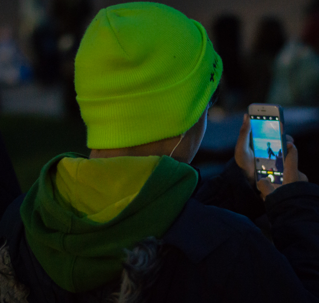 Boy with mobile watching Semaphore event